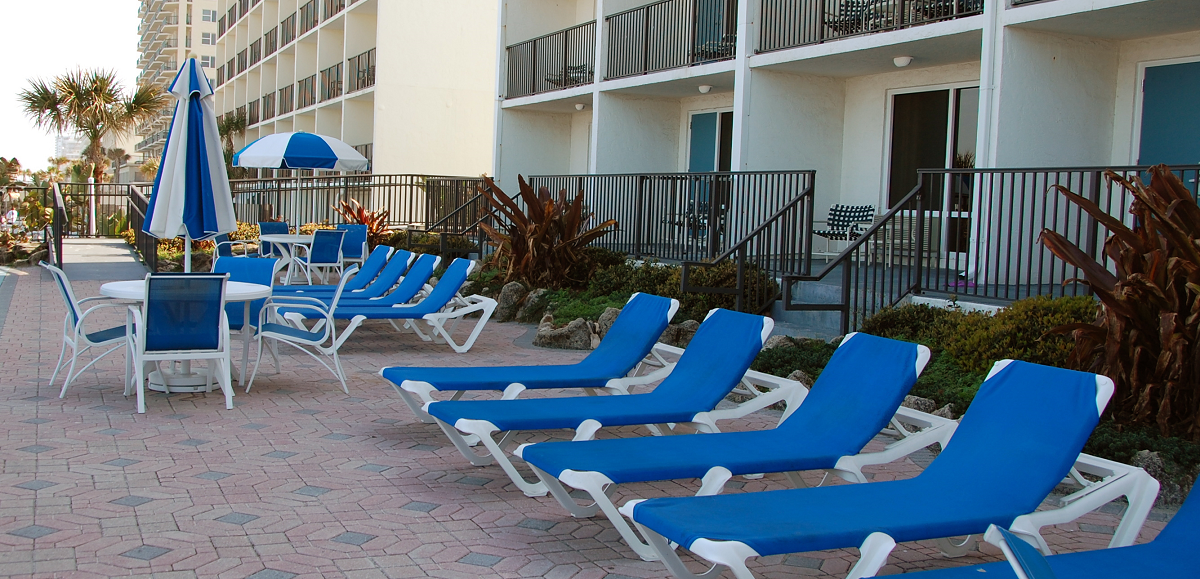 The Dolphin Beach Resort S Pool Deck Has A Stylish Combination Collection They Love Grosfillex Nautical Chaise Lounge But Didn T Like Any Of Chairs